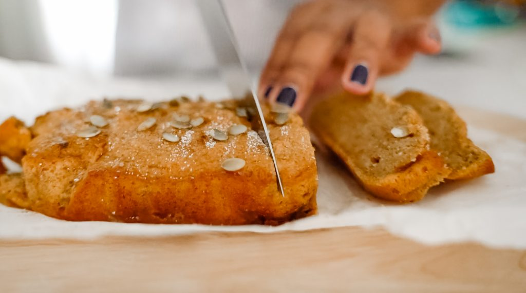 Slicing pumpkin spice bread